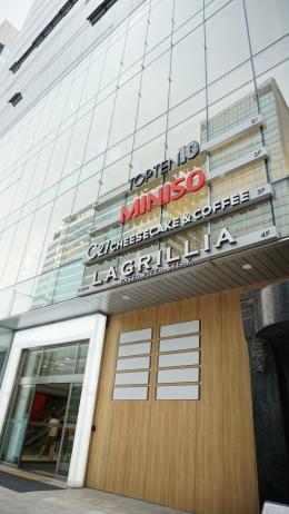C27 Cheesecake Cafe building outside Hongik University Station Exit 2